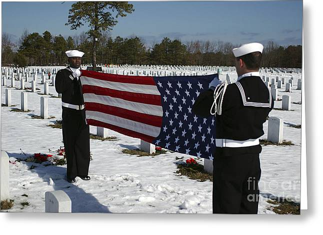Grave Side Greeting Cards - Marines Perform Flag Folding Honors Greeting Card by Stocktrek Images