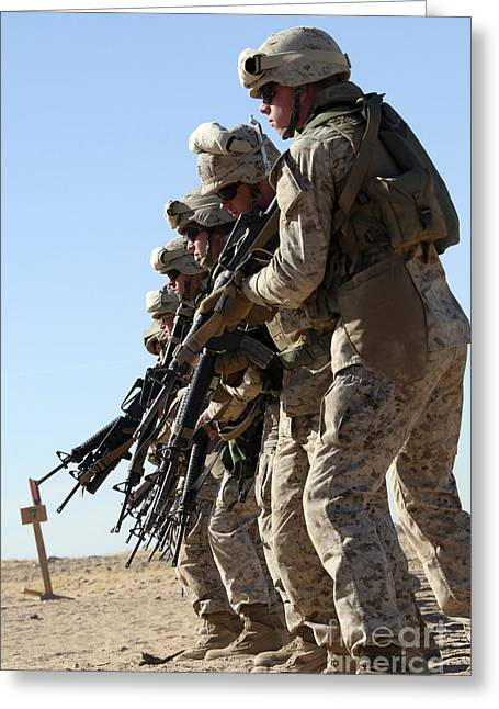 Marksman Greeting Cards - Marines Raise Their M16a2 Service Greeting Card by Stocktrek Images