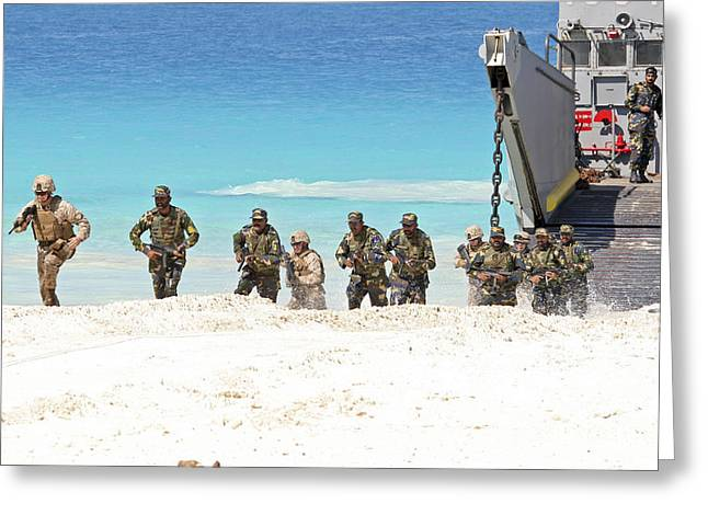 Marines Rush Ashore From A Ling Craft Greeting Card by Stocktrek Images