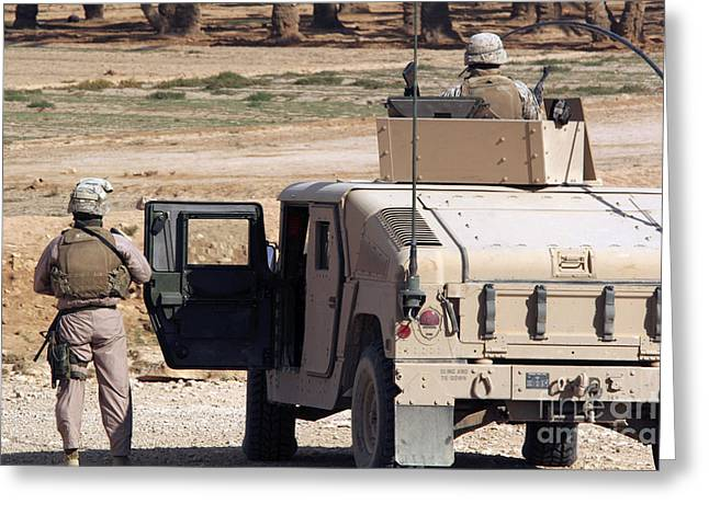 Hmmwv Greeting Cards - Marines Watch The Surrounding Desert Greeting Card by Stocktrek Images