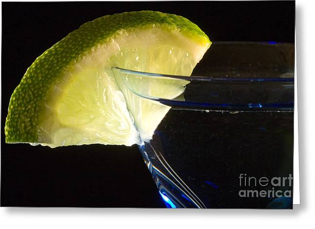 Martini Cocktail With Lime Wedge On Blue Glass Greeting Card by ELITE IMAGE photography By Chad McDermott