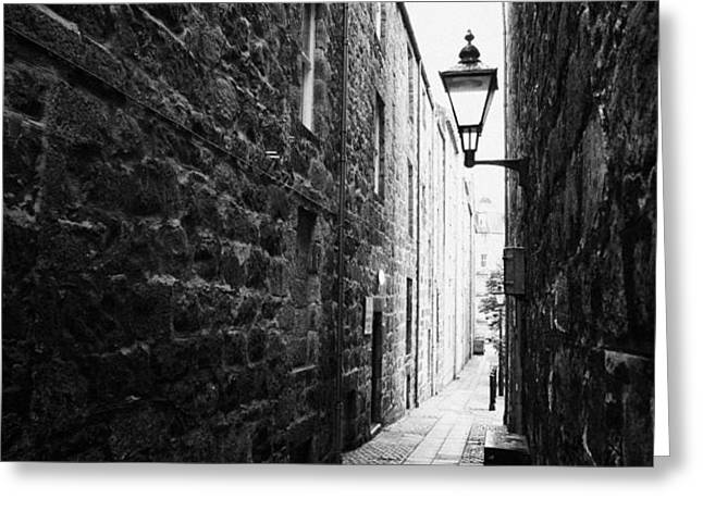 martins lane narrow entrance to tenement buildings in old aberdeen scotland uk Greeting Card by Joe Fox