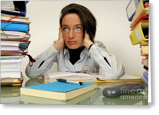 Overwork Greeting Cards - Mature office worker sitting at desk with piles of folders Greeting Card by Sami Sarkis