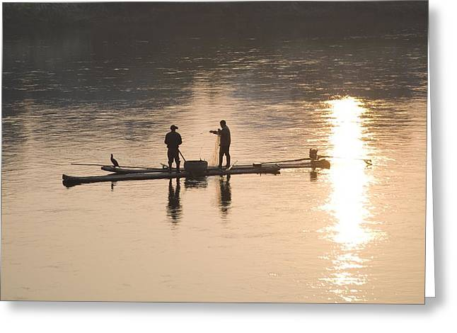 Two Fishing Men Greeting Cards - Men On A Raft Fishing Greeting Card by Keith Levit