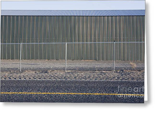 Yellow Line Greeting Cards - Metal Storage Shed Behind Fence Greeting Card by Paul Edmondson
