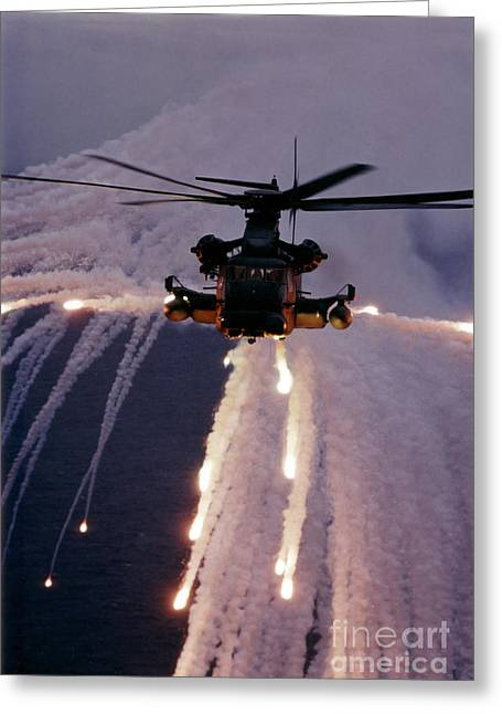 Low Wing Photographs Greeting Cards - Mh-53j Pave Low Iiie Expends Flares Greeting Card by Stocktrek Images