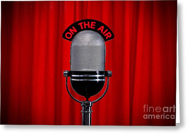 Limelight Photographs Greeting Cards - Microphone on stage with spotlight on red curtain Greeting Card by Richard Thomas