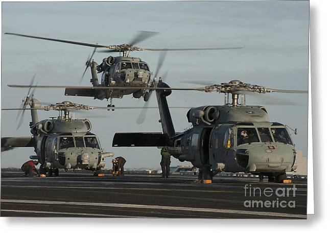 Sikorsky Photographs Greeting Cards - Military Helicopters Land On The Flight Greeting Card by Stocktrek Images