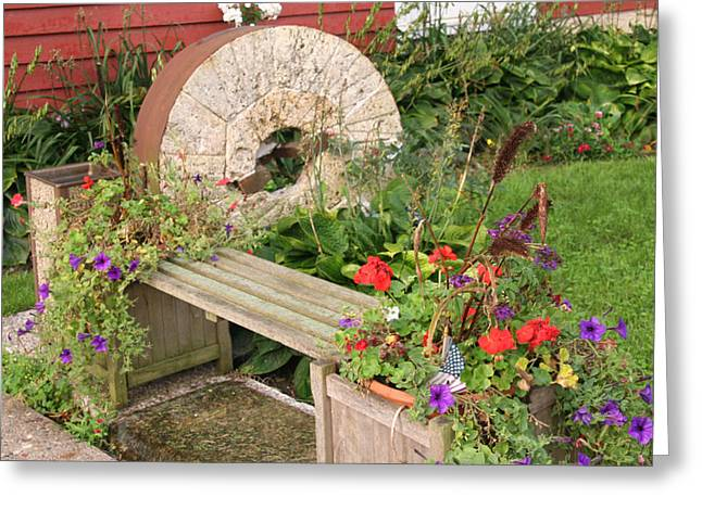 Stone Flower Planter Greeting Cards - Milling Stone Flower Garden Greeting Card by Amelia Painter