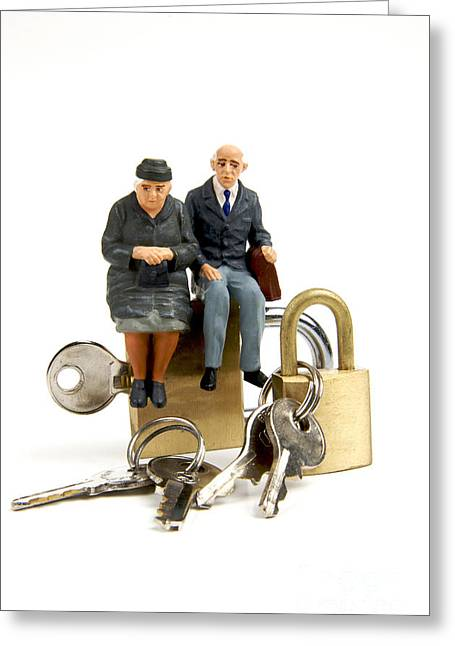 Citizens Photographs Greeting Cards - Miniature figurines of elderly couple sitting on padlocks Greeting Card by Bernard Jaubert
