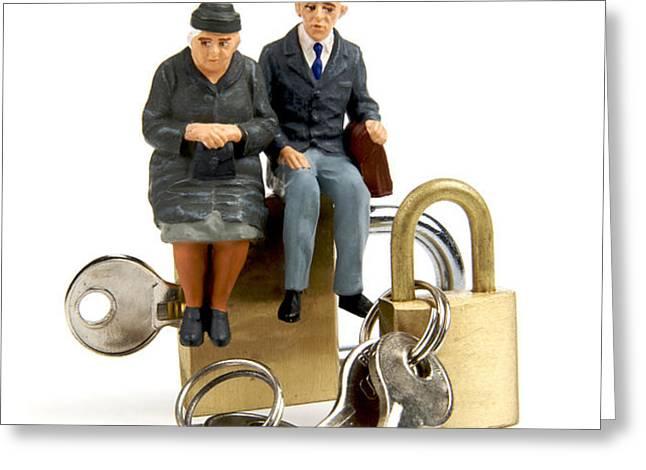 Miniature figurines of elderly couple sitting on padlocks Greeting Card by BERNARD JAUBERT