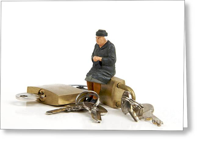 Citizens Photographs Greeting Cards - Miniature figurines of elderly sitting on padlocks Greeting Card by Bernard Jaubert
