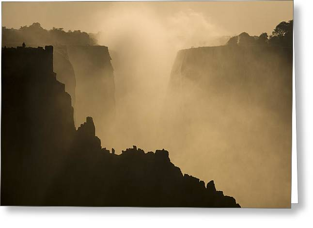 Zambia Waterfall Greeting Cards - Mist Over The Cliffs Of Victoria Falls Greeting Card by Ralph Lee Hopkins