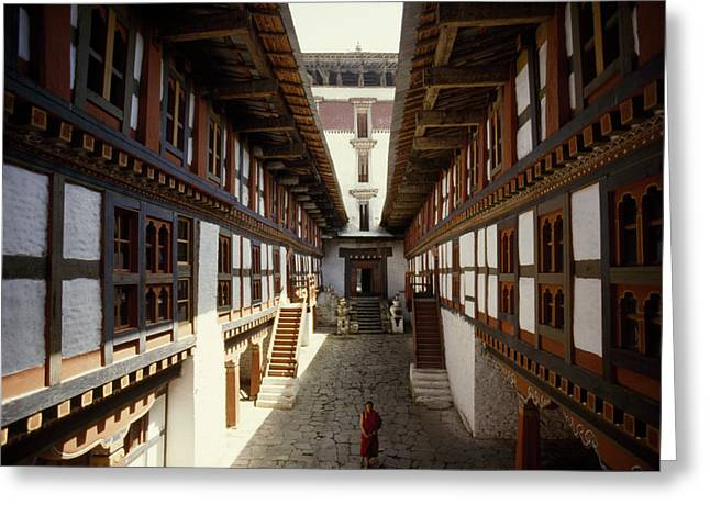 Indochinese Architecture And Art Greeting Cards - Monk Walks Through The Fortress-style Greeting Card by Paul Chesley
