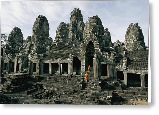 Indochinese Architecture And Art Greeting Cards - Monks In Orange Robes Stand On The Step Greeting Card by Paul Chesley