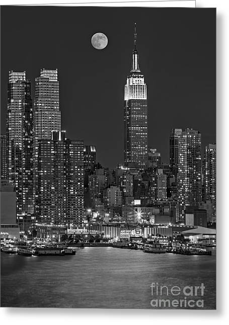 Full Moon Greeting Cards - Moonrise along the Empire State Building BW  Greeting Card by Susan Candelario