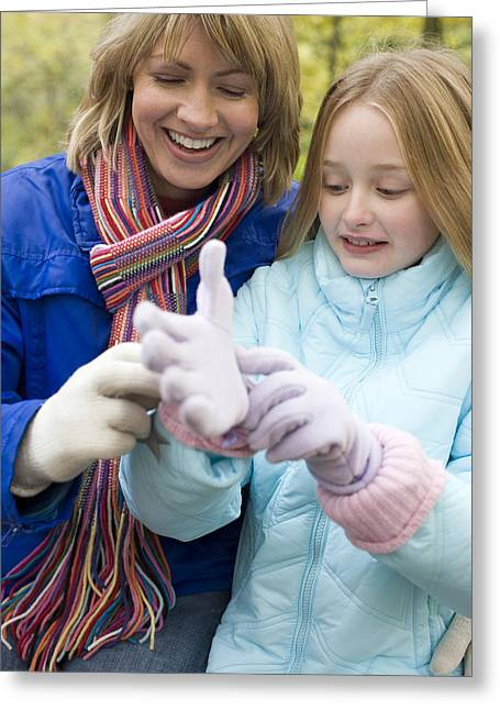 Child Care Greeting Cards - Mother And Daughter Outdoors In Winter Greeting Card by Ian Boddy