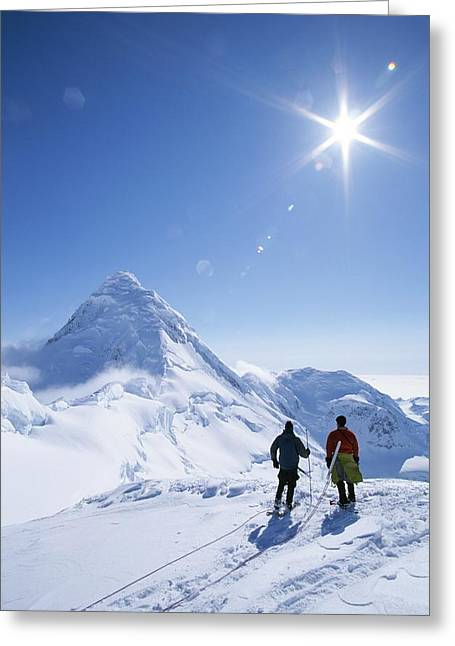 Reverence Greeting Cards - Mountain Climbers Contemplate A Distant Greeting Card by John Burcham