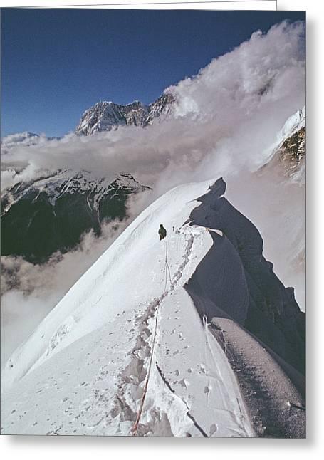 Snow Cornice Greeting Cards - Mountaineer At 20,000 On North Ridge Greeting Card by Gordon Wiltsie