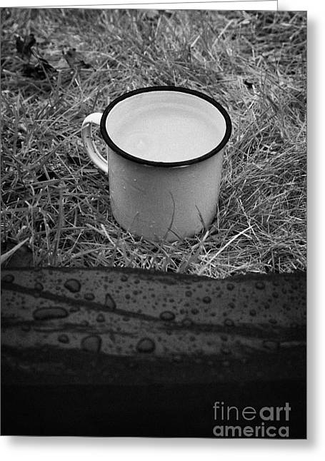 Dilute Greeting Cards - Mug Of Tea With Rain Falling In It Outside The Front Of A Tent Greeting Card by Joe Fox