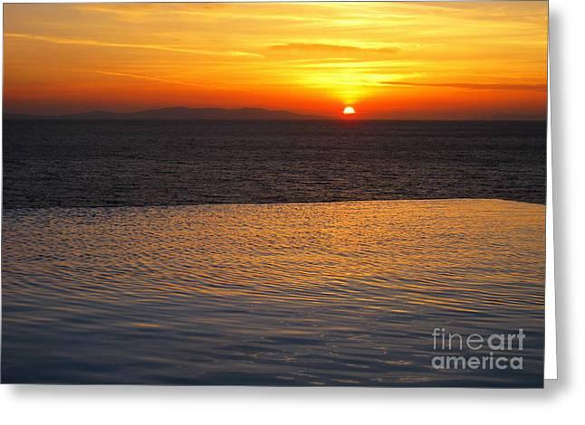 Mykonos Sunset Greeting Card by Leslie Leda