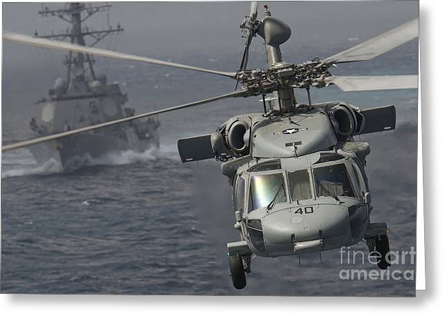 Sikorsky Photographs Greeting Cards - N Mh-60s Knight Hawk Delivers Supplies Greeting Card by Stocktrek Images