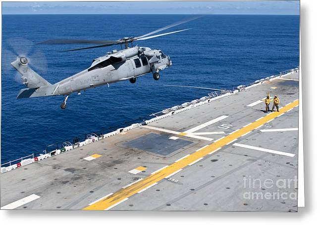 N Mh-60s Sea Hawk Helicopter Lifts Greeting Card by Stocktrek Images