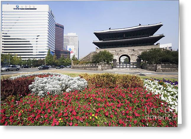 Office Space Photographs Greeting Cards - Namdaemun Gate with Flowers in Foreground Greeting Card by Jeremy Woodhouse