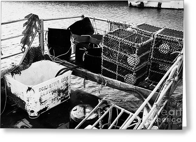 Lobster Pot Greeting Cards - new lobster pots piled up in the back of a small fishing boat at John OGroats harbour scotland Greeting Card by Joe Fox
