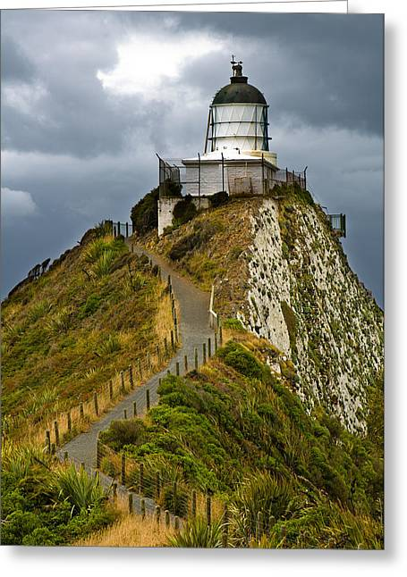 Nugget Point Light House And Dark Clouds In The Sky Greeting Card by Ulrich Schade