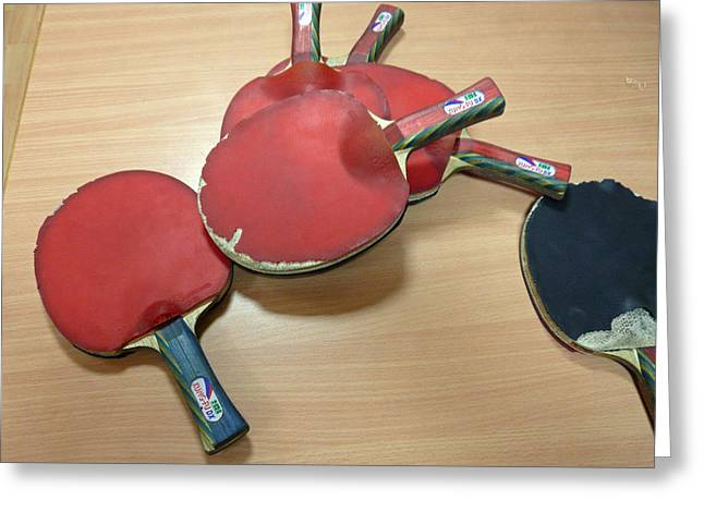Best Sellers -  - Racquet Greeting Cards - Number of ping pong bats piled on a table Greeting Card by Ashish Agarwal