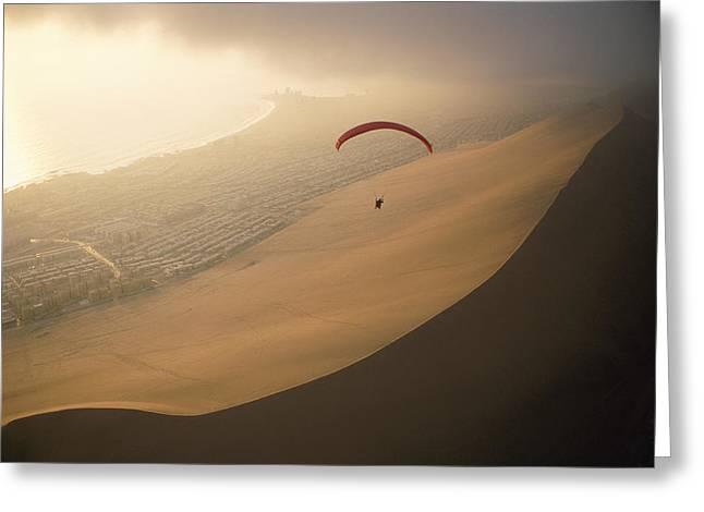 Ocean Gusts Keep A Paraglider Aloft Greeting Card by Joel Sartore
