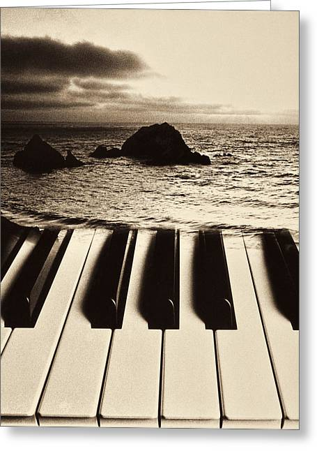 Piano Keys Greeting Cards - Ocean washing over keyboard Greeting Card by Garry Gay