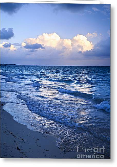 Surf Blue Greeting Cards - Ocean waves on beach at dusk Greeting Card by Elena Elisseeva