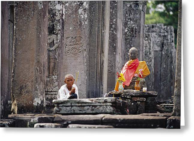 Wat Angkor Greeting Cards - Offerings Made To Buddha At Angkor Wat Greeting Card by Steve Raymer