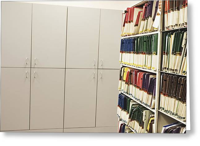 Office Cabinets and Colorful Files Greeting Card by Jetta Productions, Inc
