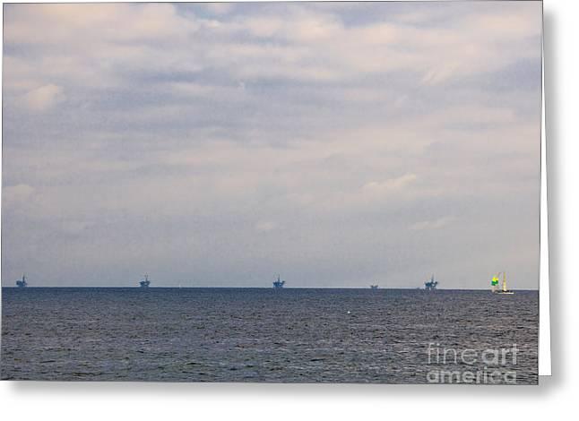 Oil Platforms In Ocean Greeting Card by David Buffington