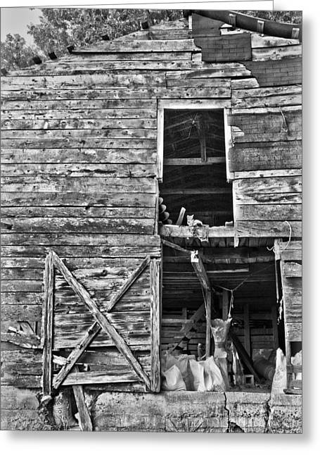 Old House Photographs Greeting Cards - Old Barn Door in Black and White Greeting Card by Debra and Dave Vanderlaan
