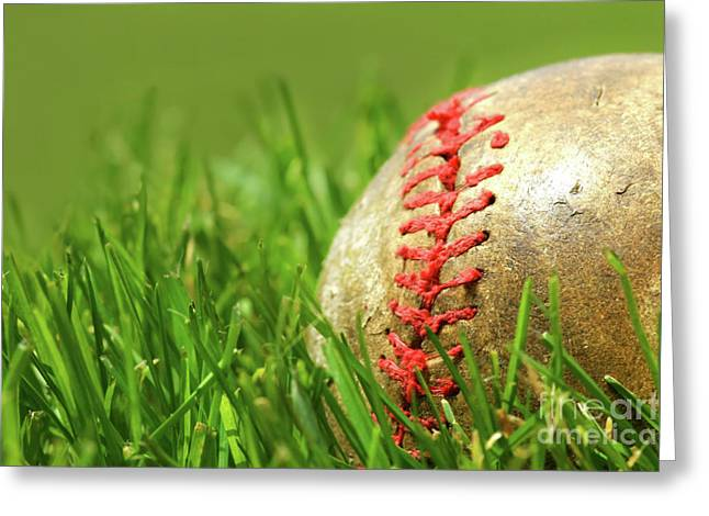American Pastime Photographs Greeting Cards - Old baseball glove on the grass Greeting Card by Sandra Cunningham