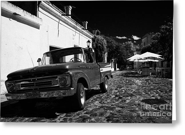 Kerb Greeting Cards - old ford pickup truck on historic paved spanish street Barrio Historico Colonia Del Sacramento Greeting Card by Joe Fox