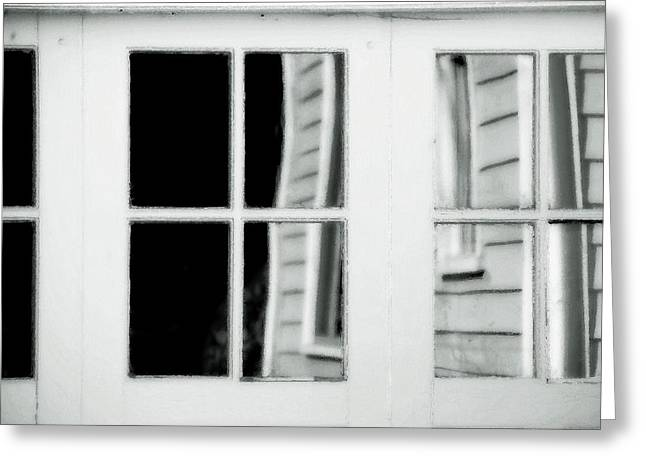Reflection In Glass Greeting Cards - Old Garage Door Greeting Card by Bonnie Bruno