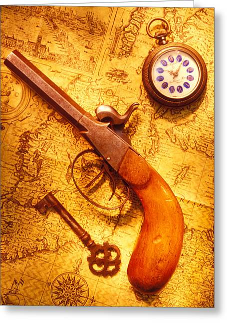 Concept Photographs Greeting Cards - Old gun on old map Greeting Card by Garry Gay