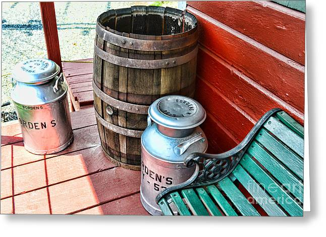 Rain Barrel Photographs Greeting Cards - Old milk cans and rain barrel. Greeting Card by Paul Ward