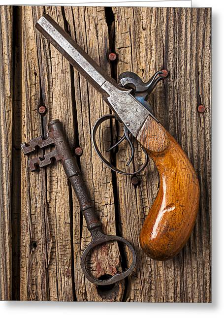 Trigger Greeting Cards - Old pistol and skeleton key Greeting Card by Garry Gay