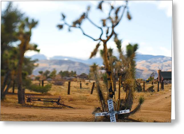 Pioneertown Greeting Cards - Old Railroad Crossing Sign in Desert Greeting Card by Eddy Joaquim