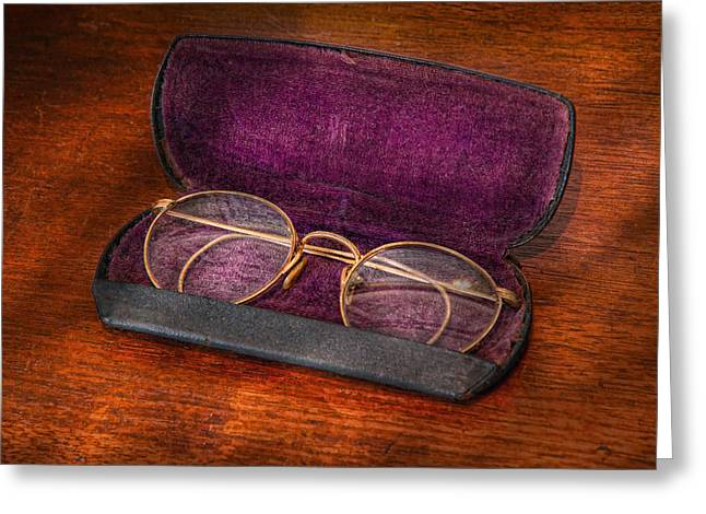 Optometry - Has anyone seen my glasses  Greeting Card by Mike Savad