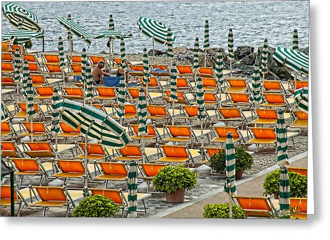Leaning Pyrography Greeting Cards - Orange Beach Chairs  Greeting Card by Mauro Celotti