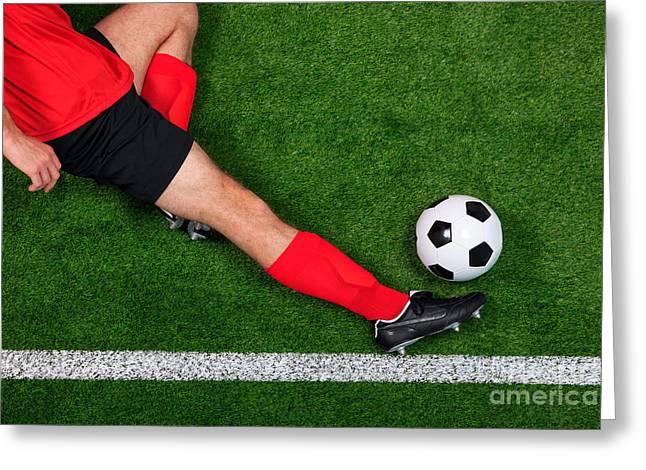 Overhead football player sliding Greeting Card by Richard Thomas