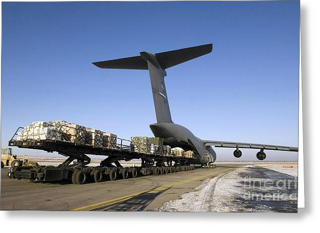 Conveyor Belt Greeting Cards - Pallets Await Loading Onto A C-5 Galaxy Greeting Card by Stocktrek Images