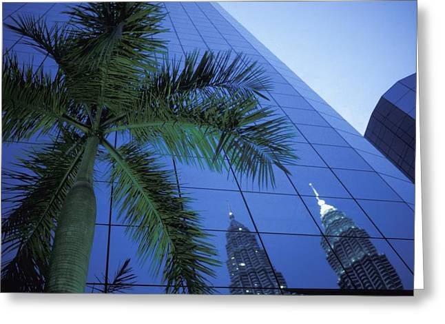 Palm Tree And Reflection Of Petronas Greeting Card by Axiom Photographic